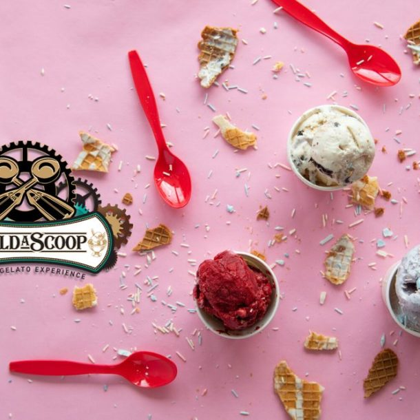 cups of ice cream on a pink background with Build A Scoop's logo